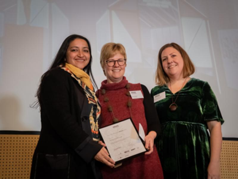 Emily McCulloch Childs presents the Award to Immigration Museum. Photo: Simon Fox, Deakin University.