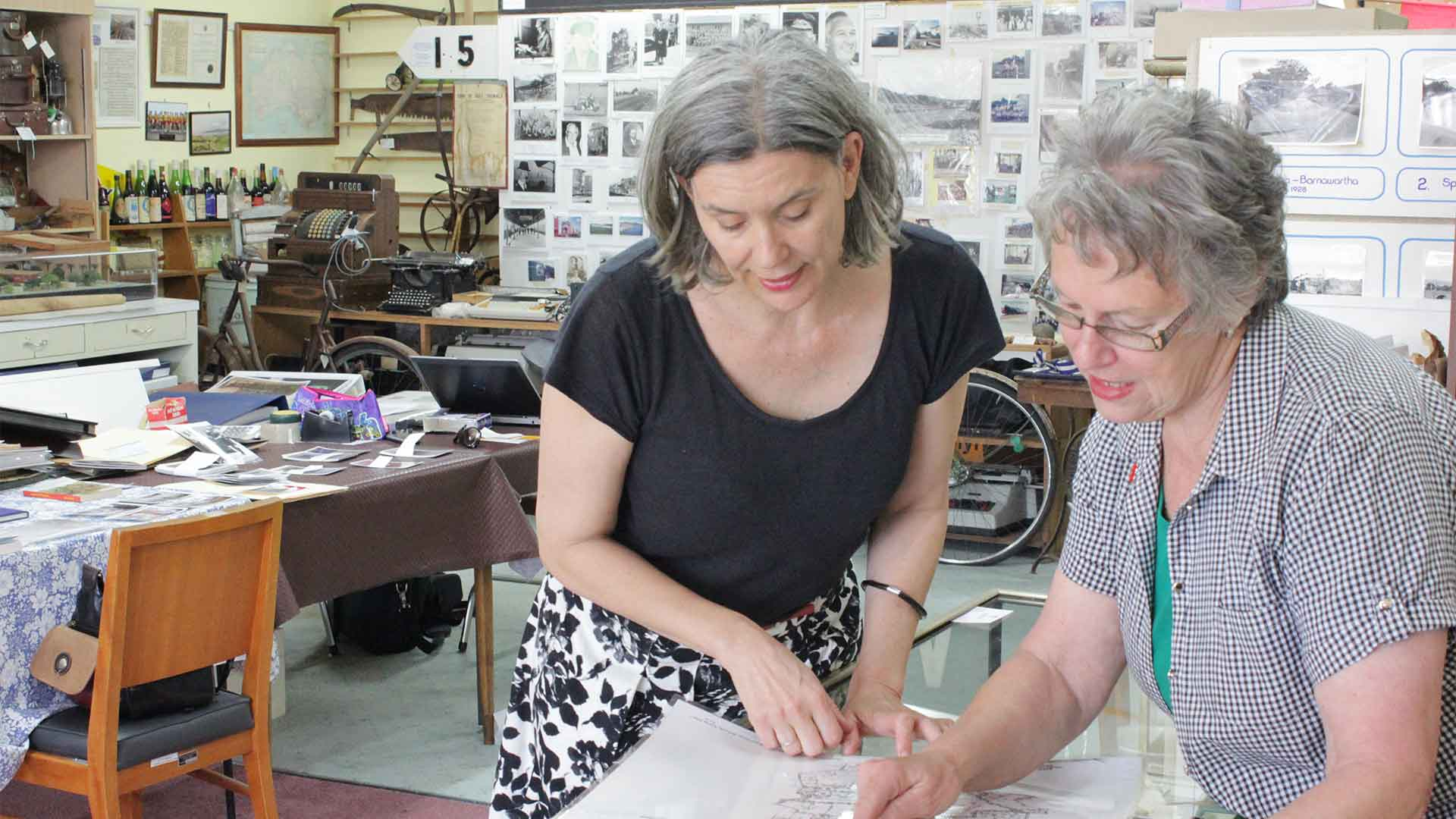 Roving Curator Kitty Owens working with Uta Wiltshire, Secretary/Treasurer of Wodonga Historical Society, on the exhibition 'Discovered: The Louis Hauesler Photographs and Family Collection'.