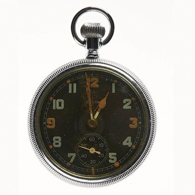 Gents pocket watch, nickel plated open case, Elgin National Watch Co, no 42060602, 1942. There is luminous radium paint on hands and 3, 9 and 12 with dots for other hours © Museums Victoria.